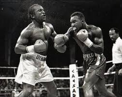 Evander Holyfield, right, is seen here knocking out former heavyweight champion Michael Dokes in the 10th round of a pitched battle.