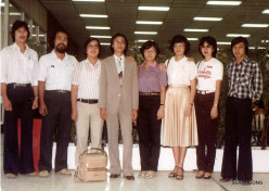 7 high schoolmates and me at the departure lounge of the airport.