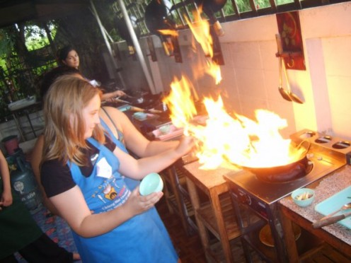 Siobhan setting the frying pan on fire during her Thai cooking course