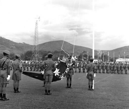 Lowering down Australian flag in 16 Sept 1975