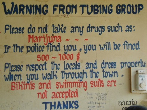 Sign outside the tubing place in Vang Vieng