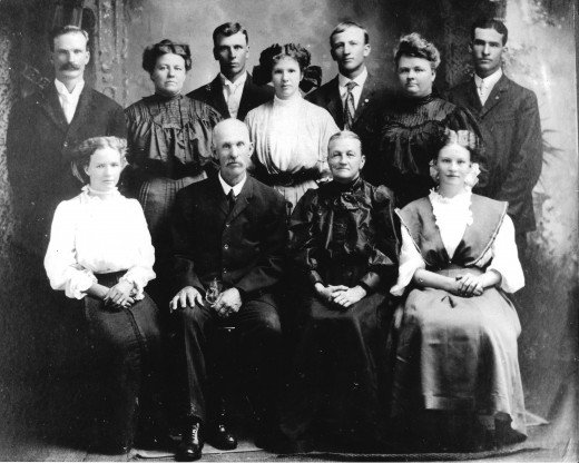 Sadie is the petite one seated on the far left.  Her parents are in the middle.  My grandmothers beloved Aunt Blanche is standing 2nd from the right.