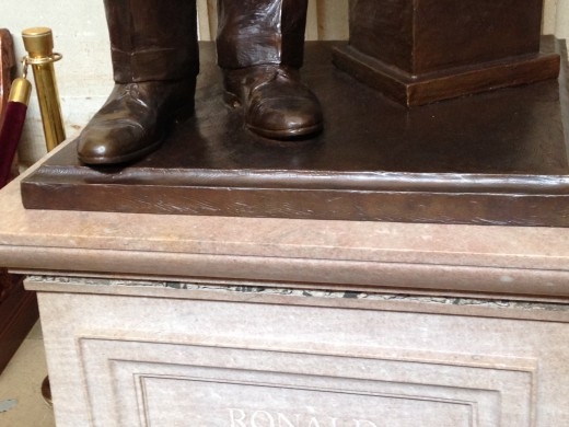 THE GRANITE LOOKING SUBSTANCE FOUR LAYERS BELOW PRESIDENT'S REAGAN'S FEET IS PART OF THE BERLIN WALL HE HELPED BRING DOWN