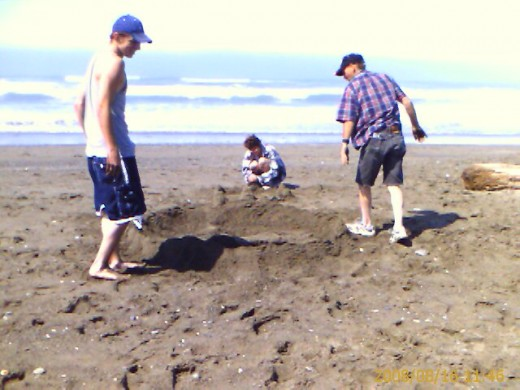 Making a sand castle with Larry, Evelyn and Corey