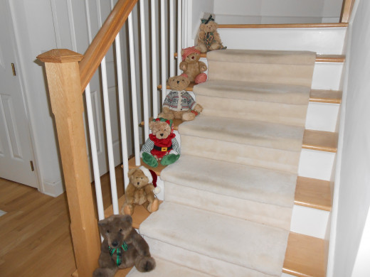 Teddy bears on the front stairs offer a warn holiday greeting to Christmas visitors, but I know I need to clean and polish the wood on the stairs first!
