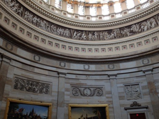 THE SCULPTURES AROUND THE BASE OF THE ROTUNDA TELLS THE STORY OF AMERICA UNTIL THE WRIGHT BROTHERS