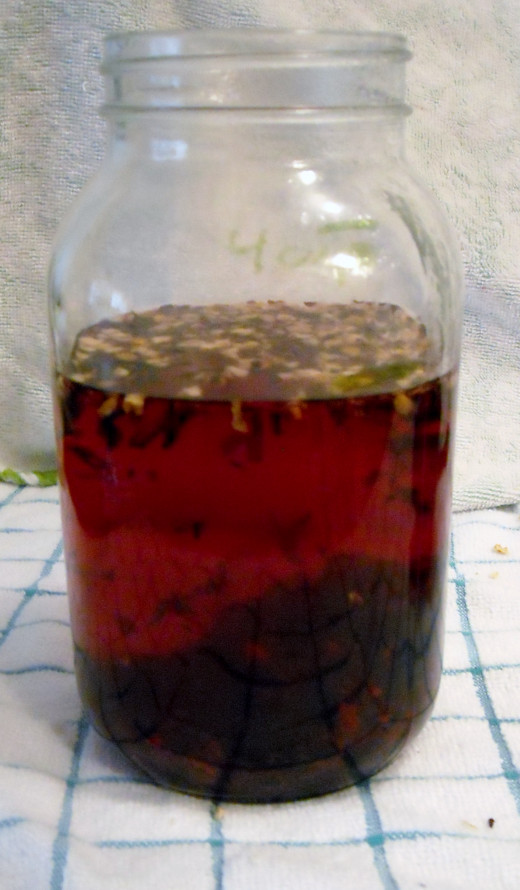 After the water has started to boil, mix herbs and water together.