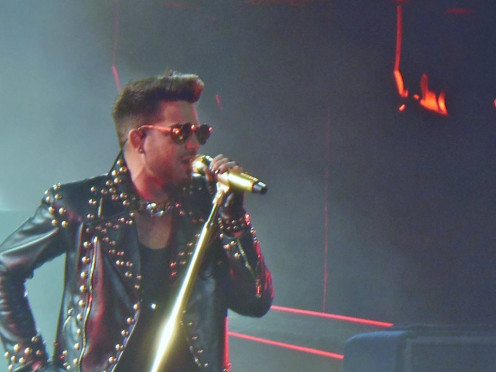 Adam Lambert sports an Armani leather-studded jacket for opening set of Queen + Adam Lambert North American tour
