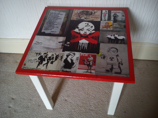 Home-made decoupage table covered with Street Art.