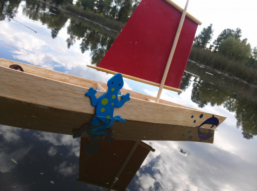 A balsa wood sailing canoe with foam sail and lizard lee board.