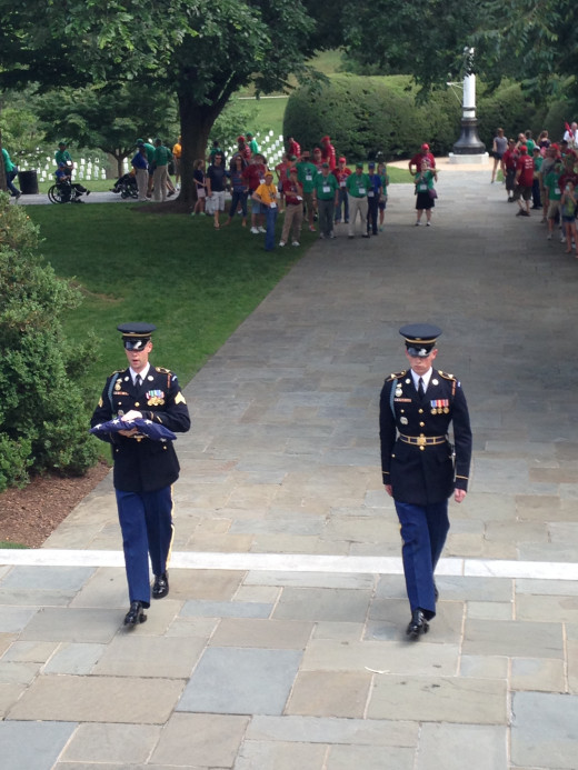 AFTER HAVING LOWERED THE FLAG AT 5:00 PM, THE GUARDS RETURN IT TO REST FOR DUTY THE NEXT DAY