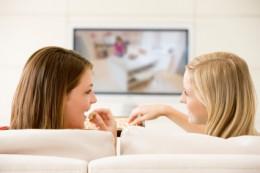 Women watching tv.