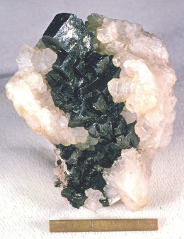 Acanthite can be found in Beaver County, Utah.  This example of Acanthite on Calcite was found in Germany