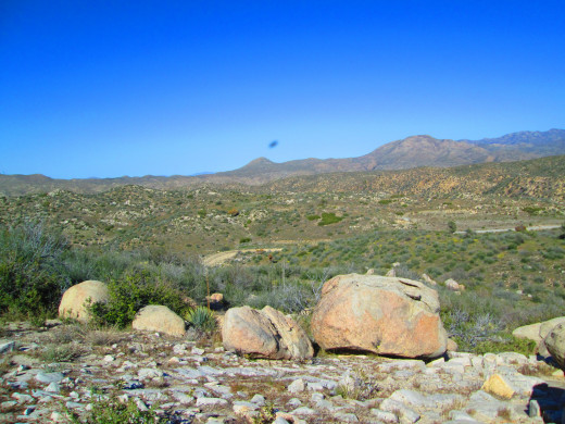 boulders in the foreground with Mount Luna in the distance.