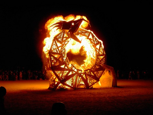 An Ouroboros ablaze. The dragon that eats its own tail recreates itself from destroying itself.