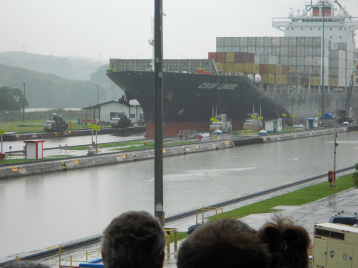 A ship traverses the Miraflores lock, which is the first of 3 sets of locks on the Canal.  Many ships a day make this journey.