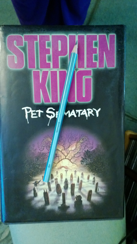 An old copy of Pet Cemetery, and a pencil
