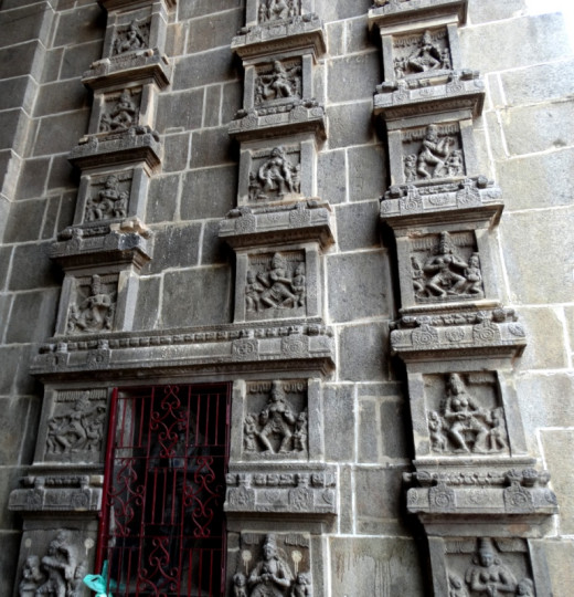 Small square panels showing different poses of Bharata Natyam in the East Gopuram