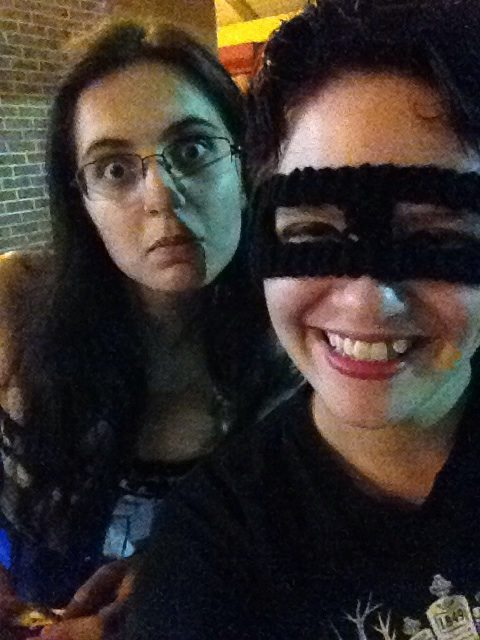"Pictured is me (with the mask) with my former roommate at a ""Mayloween"" party at The Geek Easy in Orlando. We spent most of our time sitting outside because it was too crowded and noisy for me inside, but she understood and stayed with me."