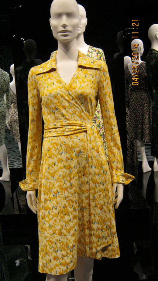 Close-up of a Diane von Furstenberg wrap dress in a yellow print