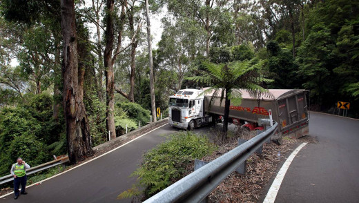 An articulated truck negotiating (or is stuck) at the most challenging hairpin of the Macquarie Pass on the Illawarra Highway (Articulated trucks beyond a certain length are no longer allowed on the Macquarie Pass - they need to use Picton Road)