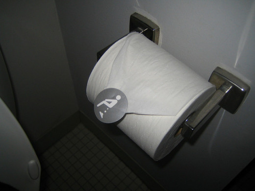 Toilet paper with clever poop sticker on it