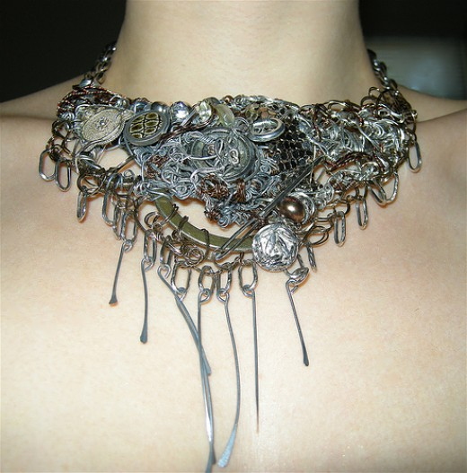 the prong like wire addition to the front of this piece is a perfect example of hand crafted BOBBLES