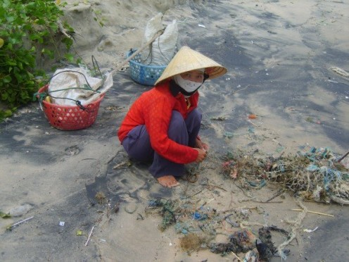 Rummaging through beach debris at Mui Ne