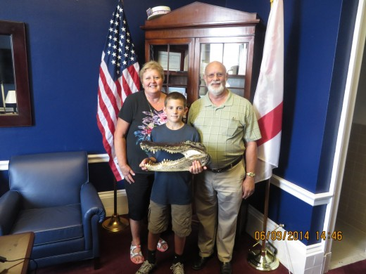 WIFE MARY, GRANDSON GRAYSON, AND MYSELF WITH UF GATOR HEAD IN REPRESENTATIVE YOHO's OFFICE