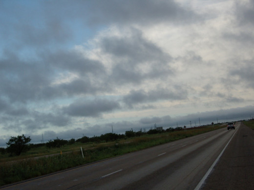 The road was devoid of traffic and it was overcast.