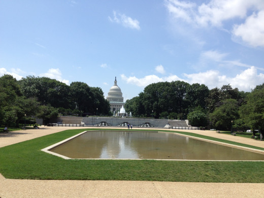 LOOKING EAST FROM OUR BUS OVER THE CAPITOL BUILDING REFLECTING POOL