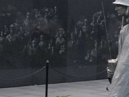 KOREAN WAR VETERAN MEMORIAL WALL.  NOTICE THE SHADOWS OF THE SOLDIER ETCHED INTO THE WALL