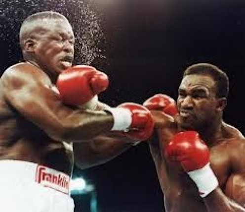 "Evander Holyfield is seen in this photo knocking out James ""Buster"" Douglas to win his first heavyweight championship."