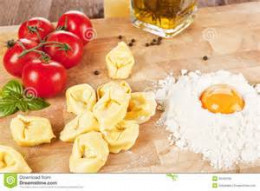 Mixing eggs flour and boiled potato.