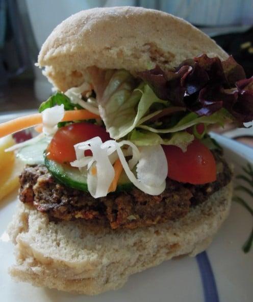 A vegan mushroom burger with salad.
