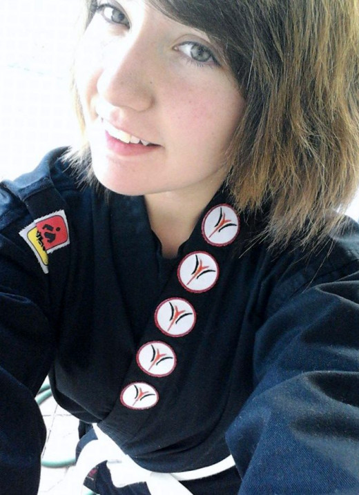 Lily - Sophomore in High School. She found a new passion - Karate! Now a purple belt!