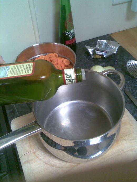 add a few glugs of olive oil (any quality)