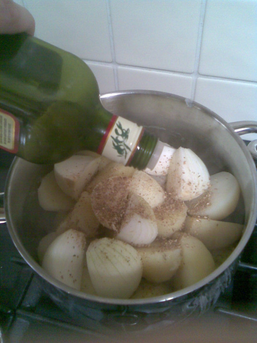 glug a little more oil on, it'll help bind the spices onto the surface of the potatoes & onions and they'll burn less in cooking.