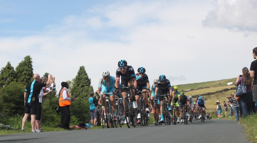 Geraint Thomas on the front of the lead bunch with Chris Froome as the Tour De France heads into the Peak District