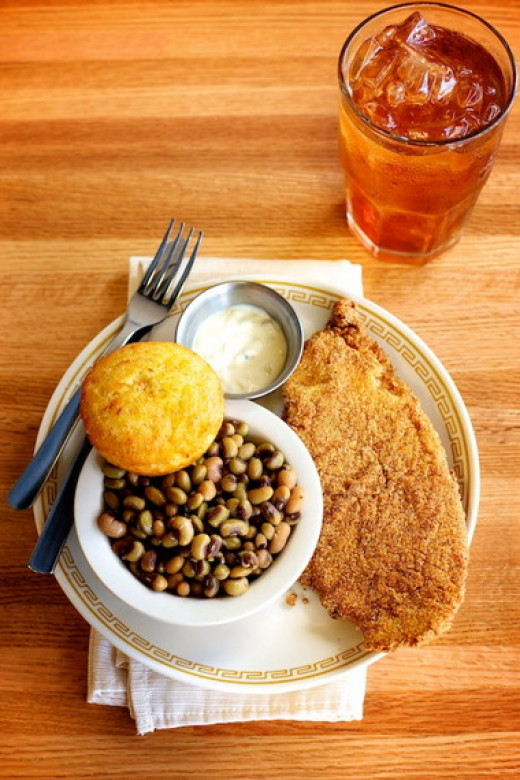Faith and Nathaniel ordered the special: catfish, black-eyed peas, and cornbread