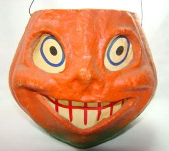 A super creepy candy container circa 1930s.