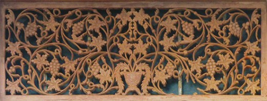 An antique wood carving in a door frame (Gale Fort).