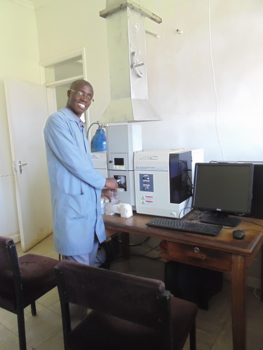 A soil analyst working in KARI Njoro Soil Chemistry Lab