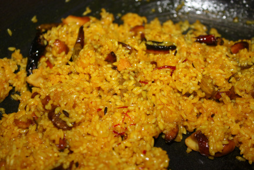 After sometime put the prepared rice in the pan. Give it a good stir. Add saffron with milk to it.  Add sugar. Sauté for few more minutes.