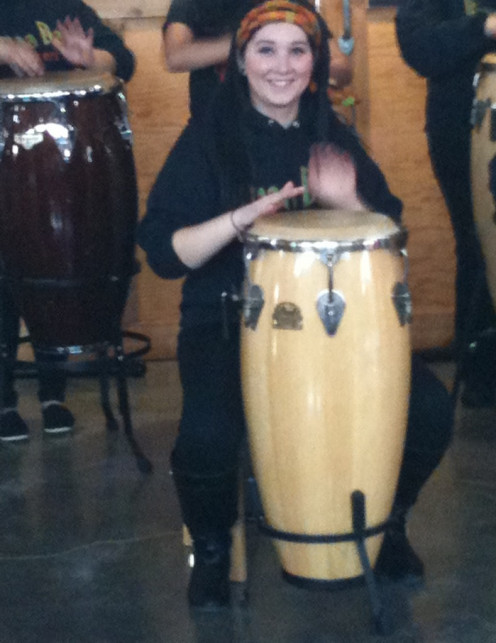 Was involved for several years drumming in her school.