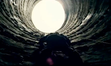 Bruce Wayne climbing the pit.