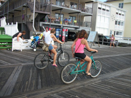 A couple of young girls riding bikes in the early morning at Ocean City, Md.
