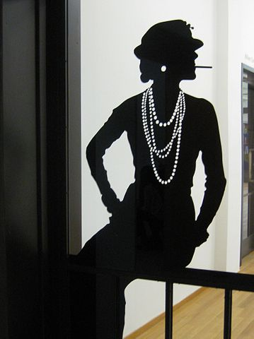 Iconic Coco Chanel pose in silhouette.