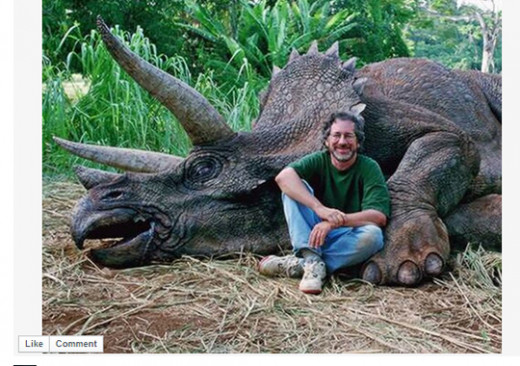 Steven Spielberg posing in front of a dead Triceratops