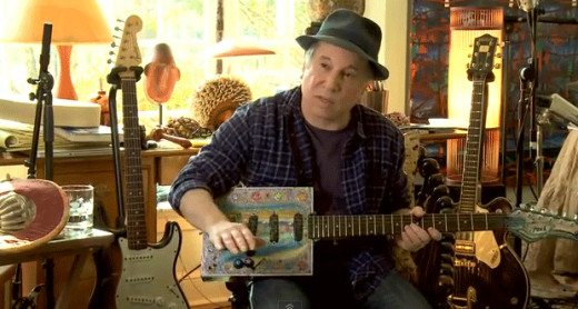 Paul Simon plays his cigar box guitar